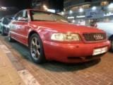 سيارة اودي نظيفة لون احمر للبيع